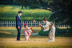 Shichi-go-san celebration at Korakuen in Okayama. Okayama, Japan - November 17 2013: Unidentified Japanese Family takes their daughter out to celebrate Stock Images