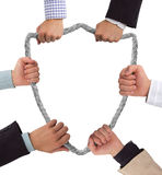 Shield. Hands holding rope forming shield Royalty Free Stock Image
