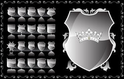 Shield. And crown on the black background Royalty Free Stock Photo