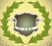 Shield with banner and wreath. Shield with silver banner and laurel wreath. Seamless pattern on background. All on separate layers Royalty Free Stock Image