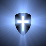 Shield with blue cross light flare. Shield with a blue cross sign illustrated with powerful light halo. Metaphor for protection, army, power etc. Extended flares royalty free illustration