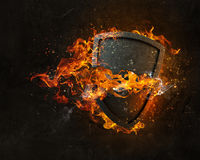 Shield burning in fire Royalty Free Stock Images