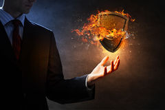Shield burning in fire Royalty Free Stock Photography
