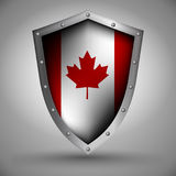 Shield with the Canadian flag Stock Images