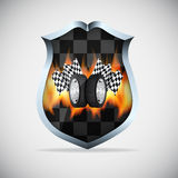Shield with checkered flags Royalty Free Stock Images
