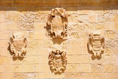 Crest carvings on a wall, Victoria, Gozo. Shield and crest carvings on a wall within the citadel, Victoria Rabat, Gozo, Malta, Europe Stock Image