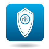 Shield with a cross icon, simple style. Shield with a cross icon in simple style in blue square. Weapon for combat symbol Royalty Free Stock Photos