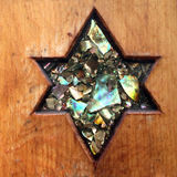 Shield of David or Star of David curved on wood Royalty Free Stock Image