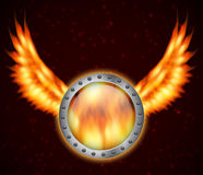 Shield with fire wings. EPS10 vector Stock Image