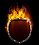 Shield in Flames. A shield on fire or surrounded by flames vector illustration