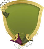 Shield with floral ornaments. Crest with floral ornaments - green with golden frame Royalty Free Stock Photo