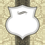 Shield Frame on Damask Background. Shield frame on seamless damask background.  Damask background is behind a clipping mask.  Colors are global, and file is Stock Photos