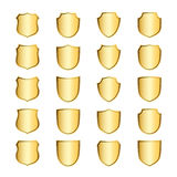 Shield gold icons set shape emblem. Gold shield shape icons set. 3D golden emblem signs isolated on white background. Symbol of security, power, protection Royalty Free Stock Image