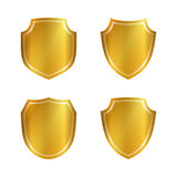 Shield gold icons set shape emblem. Gold shield shape icons set. 3D golden emblem signs isolated on white background. Symbol of security, power, protection Stock Photography