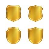 Shield gold icons set shape emblem. Gold shield shape icons set. 3D golden emblem signs isolated on white background. Symbol of security, power, protection Stock Image