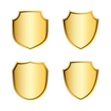 Shield gold icons set shape emblem. Gold shield shape icons set. 3D golden emblem signs isolated on white background. Symbol of security, power, protection Stock Photos