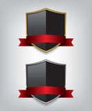 Shield gold and silver with red ribbon Stock Photography