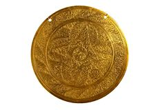 Shield of gong engraving. Shield gong engraved -from brass executed Stock Photography