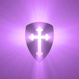 Shield with Gothic cross light flare Royalty Free Stock Images