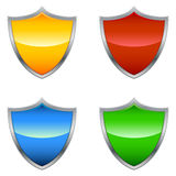 Shield Icons. A glossy shield icon in four different colors Stock Photography
