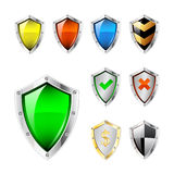 Shield icons. Set or collection of icons in the shape of shields with various designs and colors Stock Photos