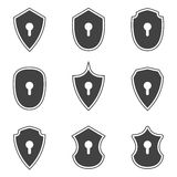 Shield icons with key holes on white background Stock Photos
