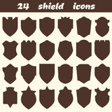 24 shield icons. Set of different shield shapes icons, borders,. Frames, labels, badges. Vector illustration Royalty Free Stock Photos