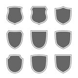 Shield icons set. Shield shape icons set. Gray label signs isolated on white background. Symbol of protection, arms, security, safety. Flat retro style design Stock Photo