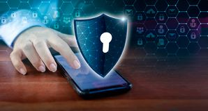 Shield Internet phone Smartphone is protected from hacker attacks, Firewall Business people press the protected phone on the inter. Net. space put message stock photos