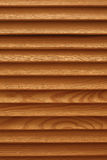 Shield with a large number of parallel wooden logs texture. Wood blinds Royalty Free Stock Image