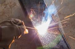 Shield metal arc welding joint steel. Shield metal arc welding joint steel in manufacturing work shop Royalty Free Stock Image