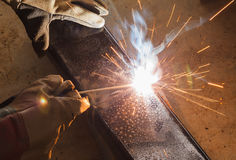 Shield metal arc welding joint steel. Shield metal arc welding joint steel in steel structure factory Royalty Free Stock Photography