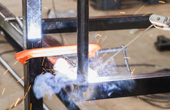Shield metal arc welding welding and C-clamp. Shield metal arc welding welding and C-clamp in fabrication work Royalty Free Stock Images