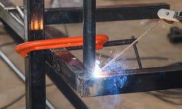 Shield metal arc welding welding and C-clamp. Shield metal arc welding welding and C-clamp in fabrication work Stock Image