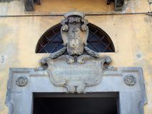 Shield on Old Building, Pisa, Italy Royalty Free Stock Images