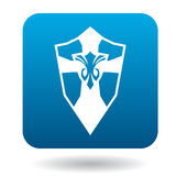 Shield with ornament icon, simple style. Shield with ornament icon in simple style in blue square. Weapon for combat symbol Royalty Free Stock Images