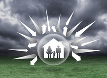 Shield protecting family from arrow Stock Photo