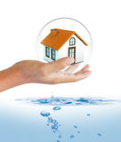 Shield protecting house from flood. Insurance concept stock image
