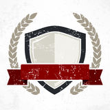 Shield with ribbon and laurel Royalty Free Stock Photography