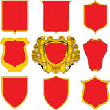 Shield Set. Various insinia shield shapes, in red and gold Royalty Free Stock Photography