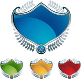 Shield Set. Colorful set of 4 3D shields Stock Photos
