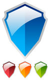 Shield shape set - Glossy colorful shields. Protection, security Stock Images
