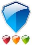 Shield shape set - Glossy colorful shields. Protection, security Royalty Free Stock Photos