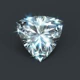 Shield shape unset diamond trillion cut. Unmounted diamond with radiant trillion cutting. Isolated sparkling gemstone with shining glare and flare Royalty Free Stock Image