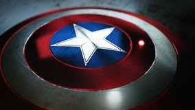 Shield with a star, superhero shield, comics shield. Scratched metal shield with star in the center on dark background royalty free illustration
