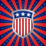 Shield on a Stars and Stripes Background. Red White and Blue Shield on a Stars and Stripes Background Stock Images