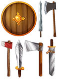 A shield, swords and axes Stock Photos