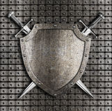 Shield and swords hanging on metal wall Stock Photos