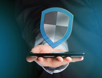 Shield symbol displayed on a futuristic interface - Security and Royalty Free Stock Photography