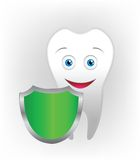 Shield and tooth. On the gray background Stock Photography